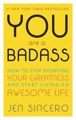 """A photograph of the yellow book cover """"#1 New York Times Bestseller; You Are a Badass: How to Stop Doubting Your Greatness and Start Living an Awesome Life; Jen Sincero"""""""