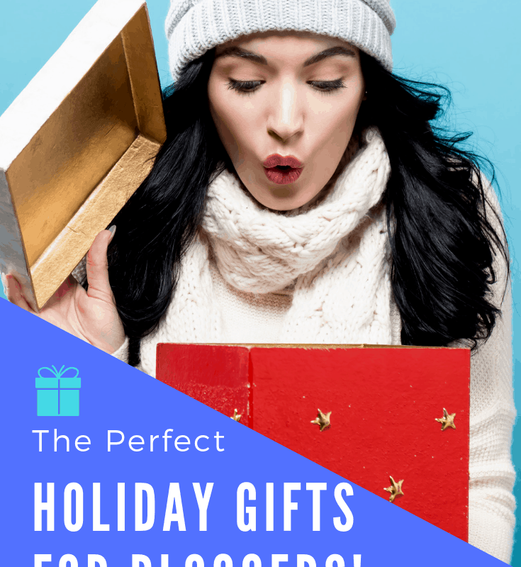 """A pinnable image of a woman opening a gift box and text that says """"The perfect holiday gifts for bloggers!"""""""