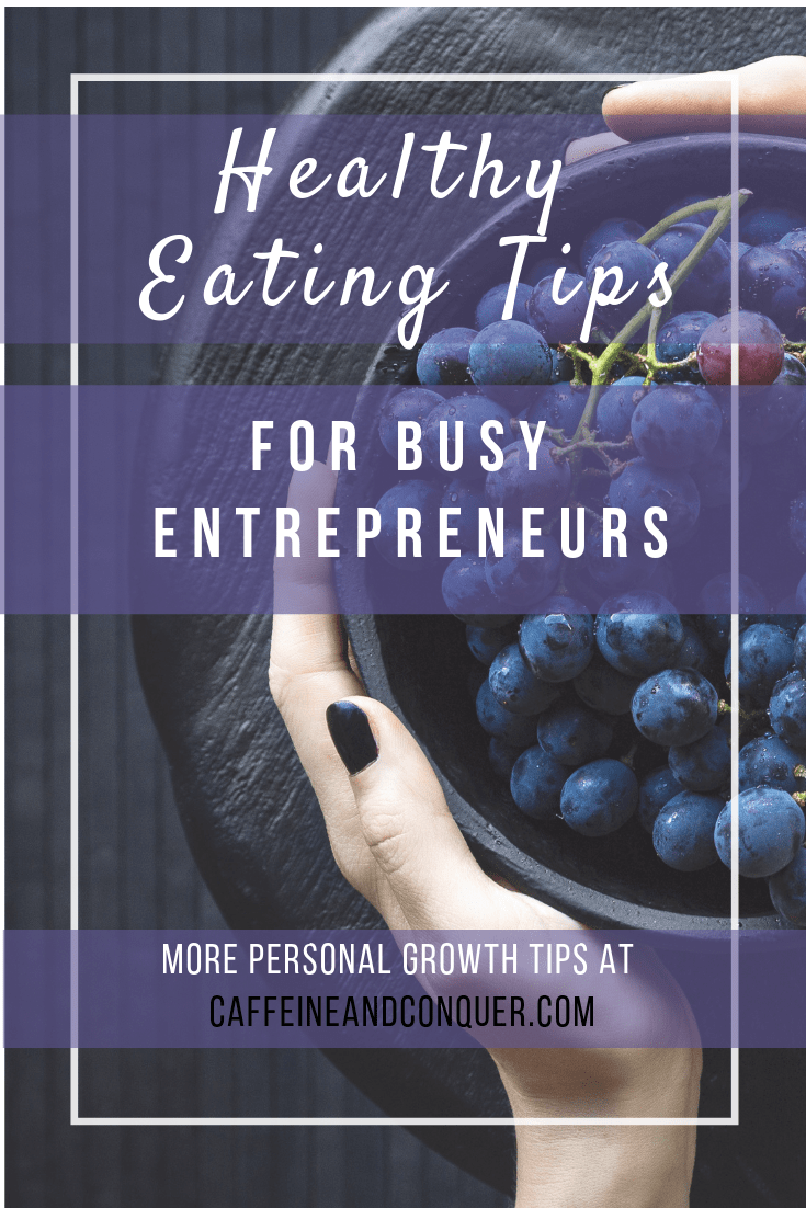 "Pinnable image of a womens hands holding a bowl of grapes. Text overlay: ""Healthy Eating Tips for Busy Entrepreneurs. More Personal Growth Tips at Caffeineandconquer.com"""